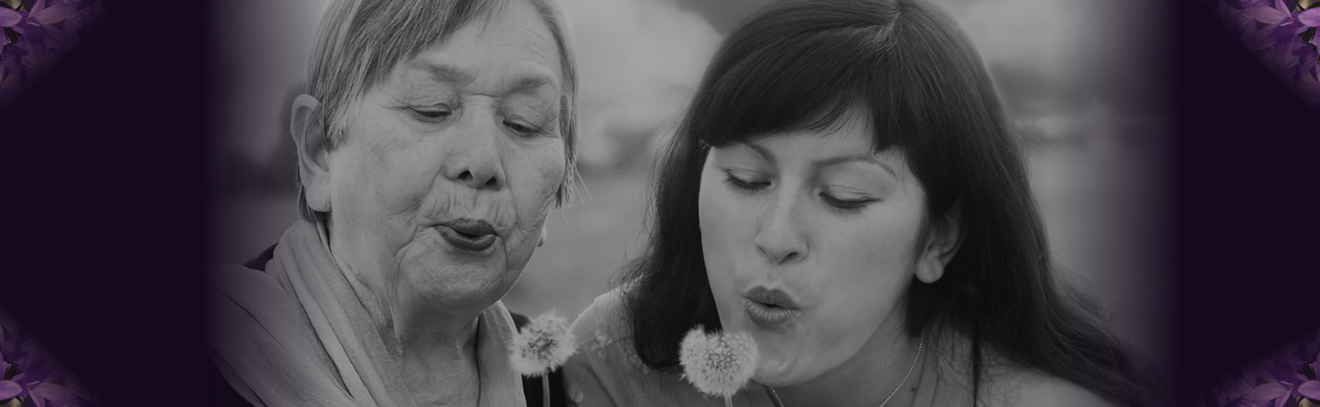 old woman and lady blowing dandelion