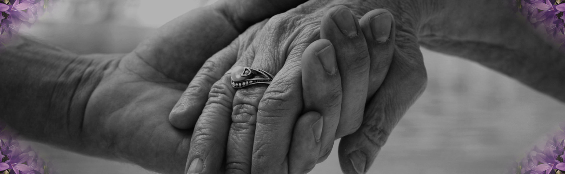 elderly holding each other's hands