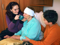 caregivers taking care of an elderly person