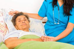 caregiver taking care of an elderly person